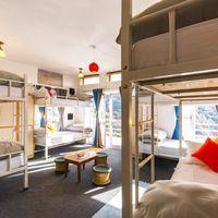 Bright, sunlit dorm at Zostel Mukteshwar