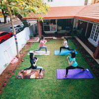 Yoga session in Mysore hostel lawn
