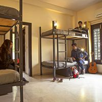 Backpackers chitchatting in Zostel South Delhi dorms