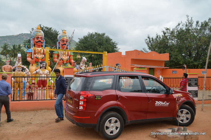 Zoomcar xuv500 in front of roadside temple